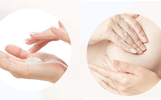 Picture of hands rubbing cream onto breasts