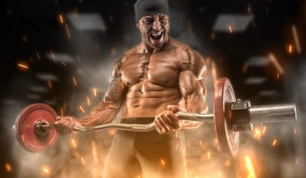 Intense athlete performing an arm curl routine