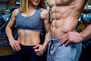 Beautiful sports body couple promoting supplement reviews