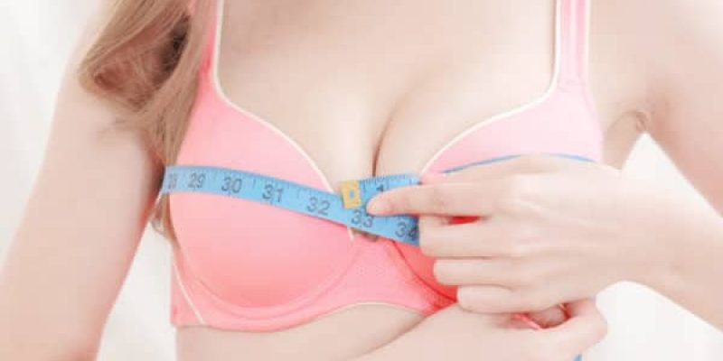 Top 3 Best Breast Enhancement Creams used by woman measuring her breasts
