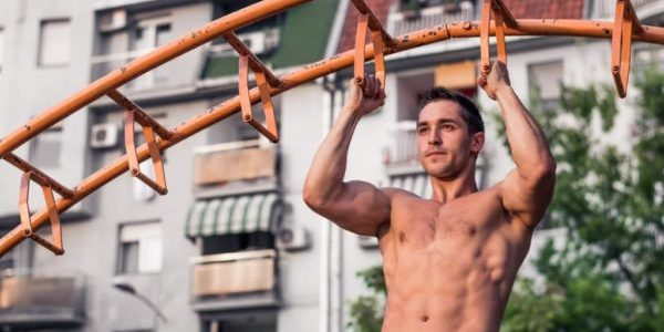 Fit Muscular man during his workout on the street