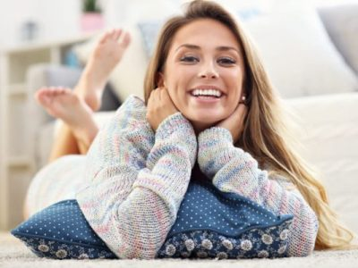 A happy woman relaxing using healthy womens lifestyle products