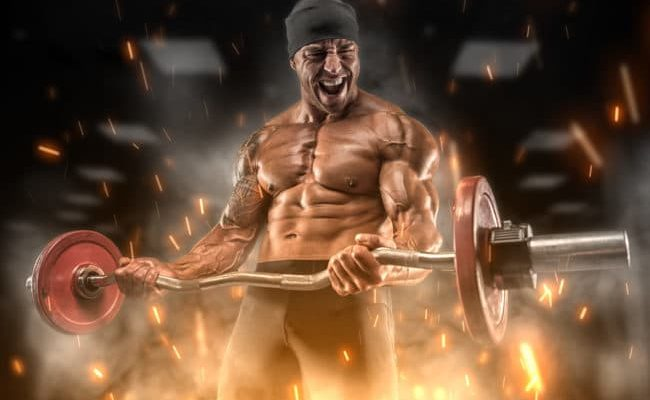 Angry athlete uses legal steroid alternative supplements training in the gym