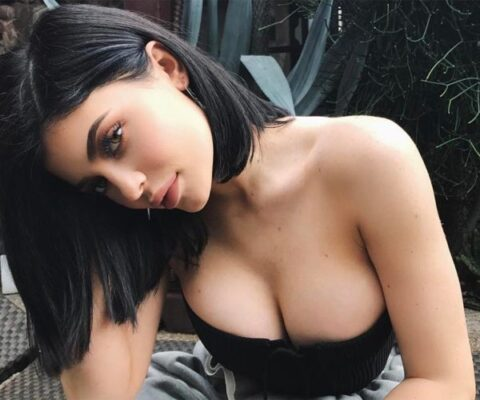 Large breasted woman head turned to the side