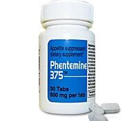 Phen375 Bottle and 3 diet pills side by side