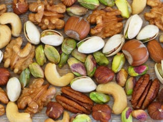 Selection of healthy nuts, almonds and sultanas