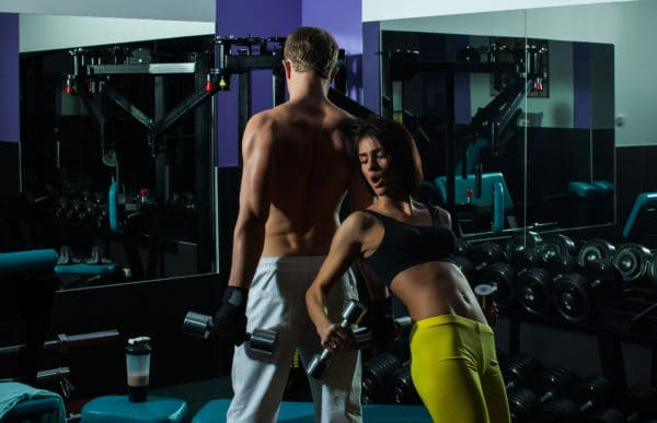 Couple working out hard at the gym